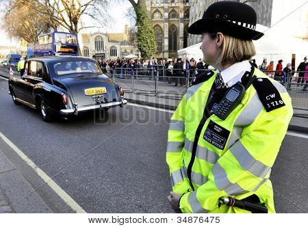 LONDON, UK - MARCH 12: A police woman outside Westminster Abbey where Queen Elizabeth II attends the Commonwealth Day ceremony on March 12, 2012 in London, UK.