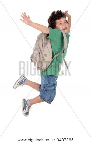 Happy Child Jumping With Backpack