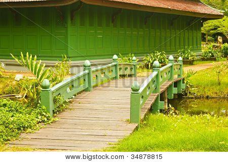 Nice Old Wooden Bridge In Park At Summertime.