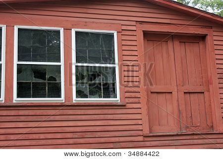 Brown barn and broken windows