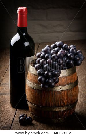 Bottle Of Red Wine, Barrel And Grape