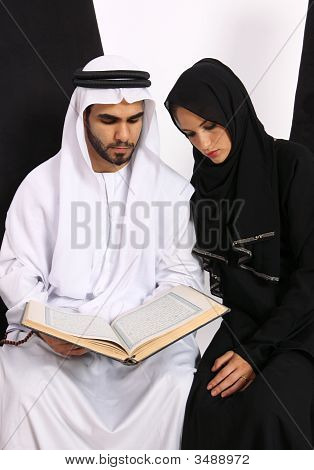 Emirati Couple Holding The Holy Quran