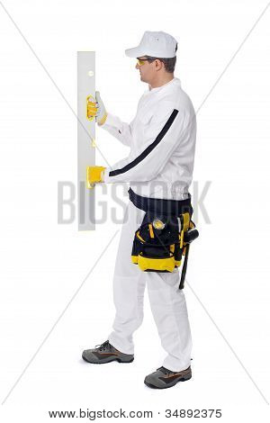 Construction Worker In White Coveralls Smooth Wall Level Nivel Tool