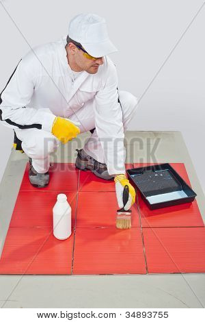 Worker Brush Primer Grout Of Red Tiles