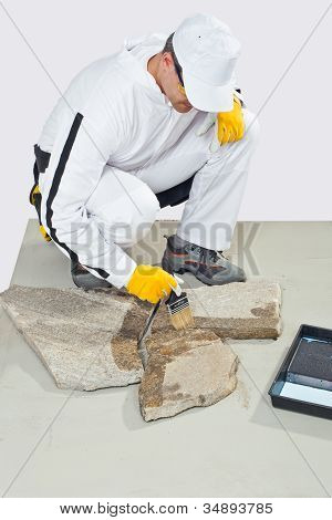 Worker Brush Primer Grout Of Stones