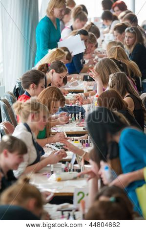 MOSCOW - APRIL 19: Unidentified orphan children, age 13-16, compete in manicure at the contest Young Master on April 19, 2013 in Moscow. Orphans were trained by charitable foundation Color of Life