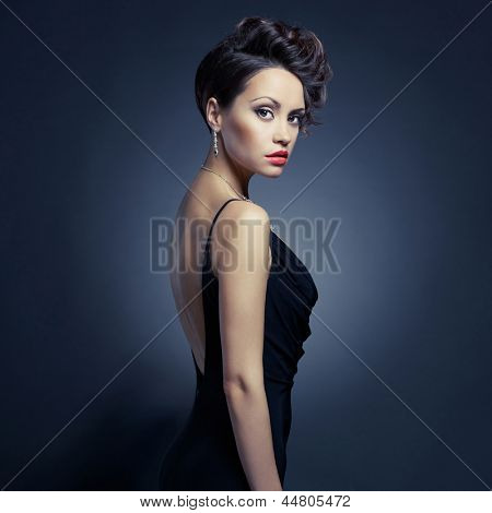 Fashion photo of beautiful lady in elegant evening dress