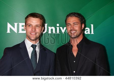LOS ANGELES - APR 22:  Jesse Spencer, Taylor Kinney at the NBCUniversal Summer Pres Day 2013 at the Huntington Langham Hotel on April 22, 2013 in Pasadena, CA