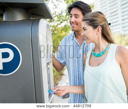 Couple paying for the parking lot with a credit card