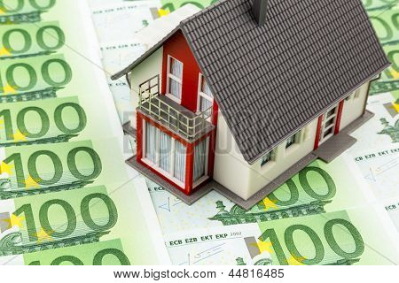 house on bills, symbolic photo for home purchase, financing, building society