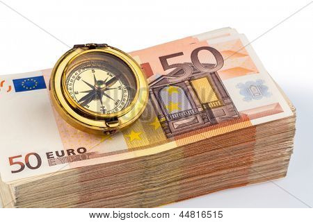 compass on euro banknotes, symbolic photo for europe, monetary union and the outlook for the european currency