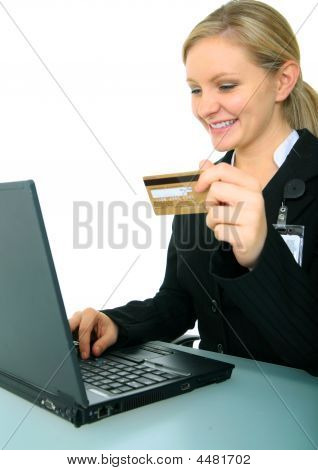 Smiling Young Businesswoman With Credit Card And Laptop