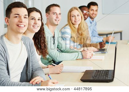 Happy students learning in seminar of an university