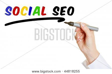 Hand with pen writing Social SEO into the air