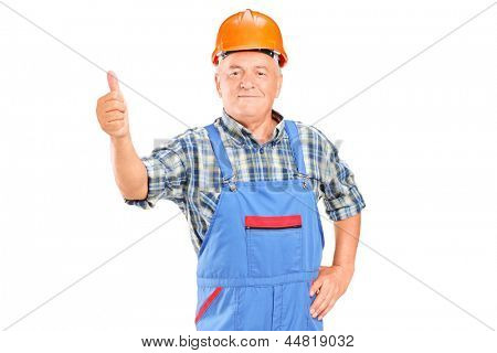 A male worker with helmet giving a thumb up isolated on white background
