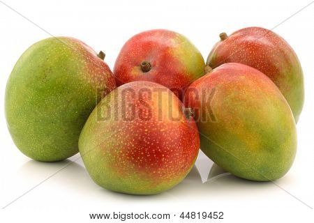 fresh mango fruits on a white background