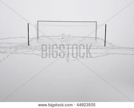 football field in winter. under the snow