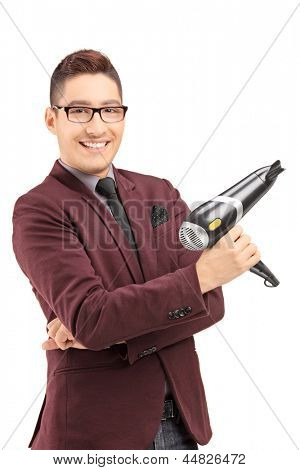 Smiling male hairdresser holding a blow dryer, isolated on white background