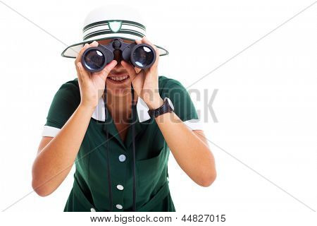 smiling girl looking at the camera using binoculars on white background