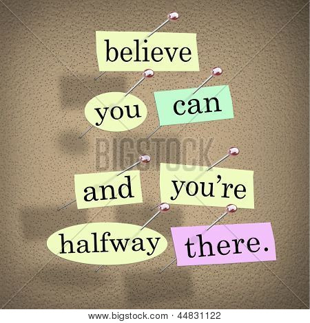 The saying Belive You Can and You're Halfway There on pieces of paper pinned to a bulletin board to symbolize belief, confidence, dedication and determination