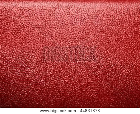 Soft wrinkled red leather. Texture or background with copyspace, high resolution