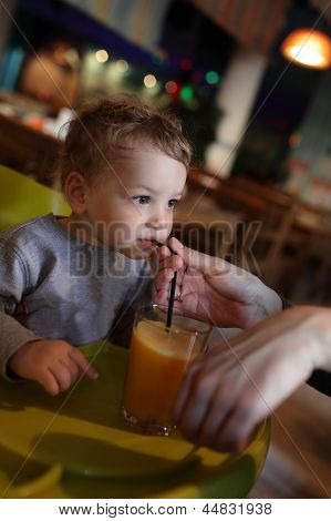 Boy Drinks Juice