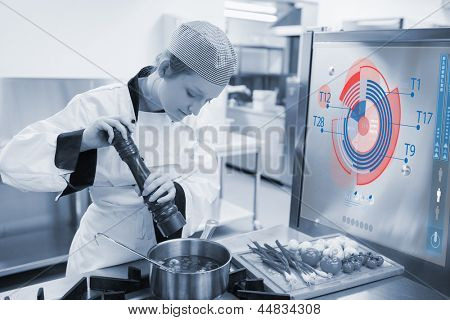 Chef cooking for a restaurant with futuristic interface that helps her