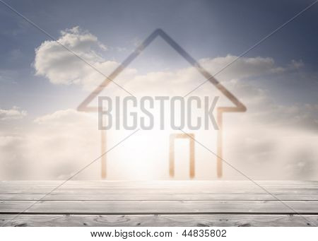 Drawing of a house over wooden boards and clouds with blue sky in the background