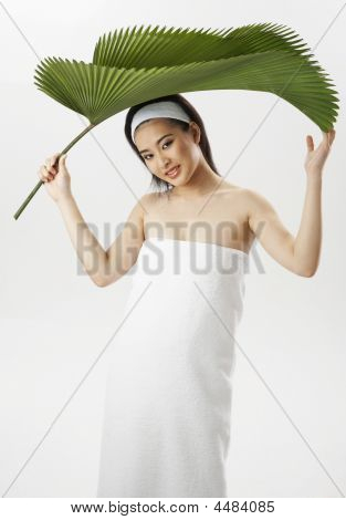 Woman Holding Big  Leaf