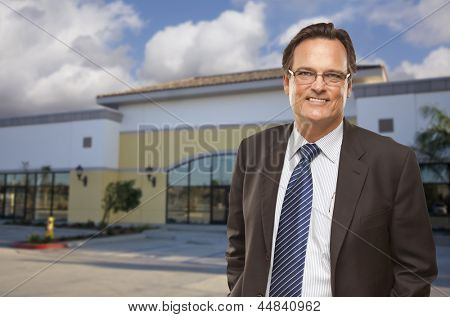 Handsome Businessman In Front of Vacant Office Building.
