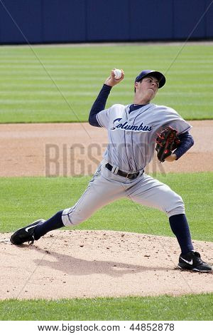 Columbus Clippers pitcher Trevor Bauer fires a pitch during a game