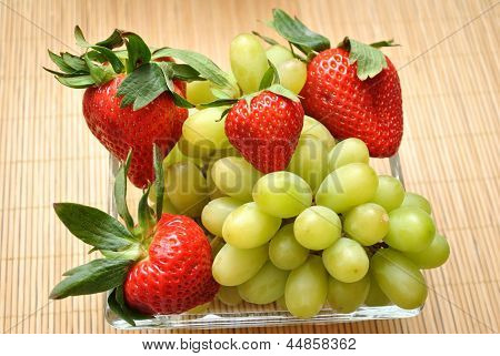 Fresh Green Gapes and Whole Red Strawberries