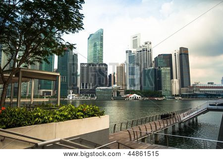 SINGAPORE - APRIL 15: A view of city in Marina Bay business district on April 15, 2012 on Singapore. Asian financial center, city-state is one of the most dynamically developing countries in the world