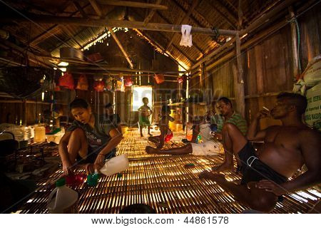 BERDUT, MALAYSIA - APR 8: Unidentified people Orang Asli in his house on Apr 8, 2013 in Berdut, Malaysia. More than 76% of all Orang Asli live below the poverty line, life expectancy - 53 years old.
