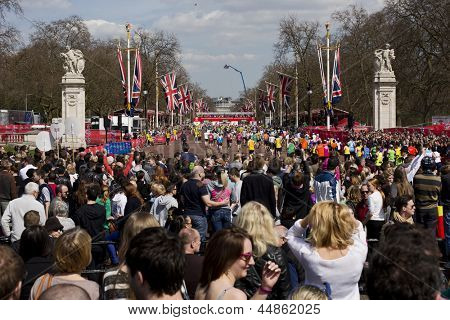 LONDON, UK - APRIL 21: The Finish Line of London Marathon just opposite Buckingham Palace with runners approaching the end of the marathon on April 21, 2013 in London, UK.