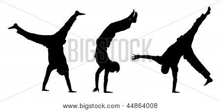 Teens Walking On Hands Silhouettes