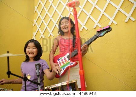 Live Concert At Home Two Little Girls Playing