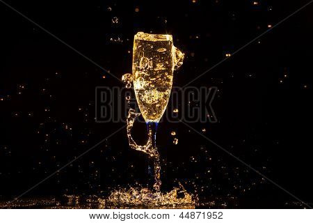 Champagne pouring in glass on a black background