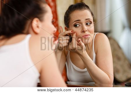 ..woman Finding An Acne On Her Cheek
