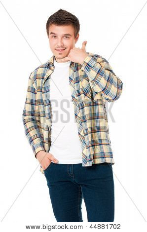 Young man in shirt making a call me gesture, isolated on white background