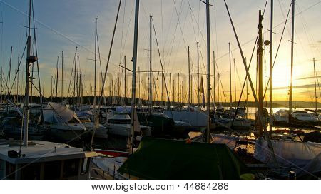 Sailboats at pier at sunset