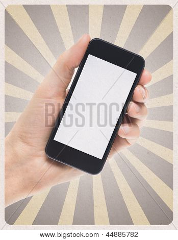 Mobile Smartphone In Hand On Retro Background