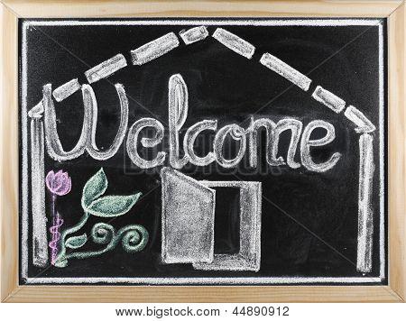 Welcome Message Written In A Blackboard