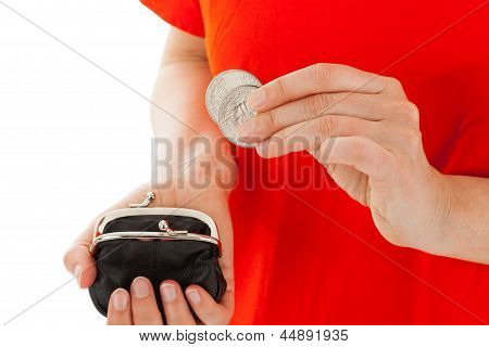 The Young Woman Has A Coin In The Hands