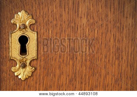 Keyhole On Wooden Background