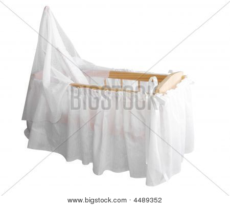 Wooden Bassinet With White Drapes