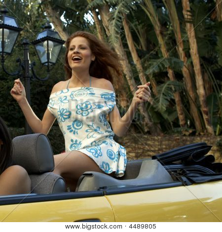 Pretty Woman In Convertible Car