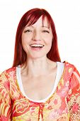Portrait of happy best ager woman with red hair