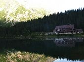 Mountain hut reflex in the lake