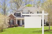 stock photo of real  - Blank Real Estate Sign in Front of Beautiful New House - JPG